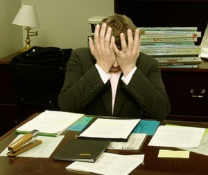 Frustrated_man_at_a_desk_(cropped)